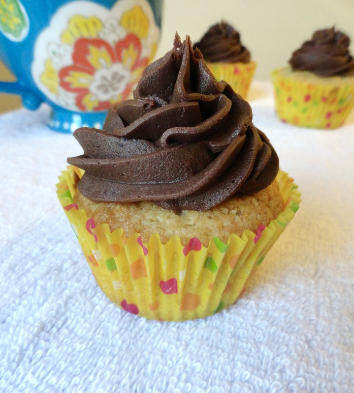Classic Yellow Cupcakes with Chocolate Frosting - Moist yellow cupcakes with a classic chocolate buttercream frosted on top. - Kate's Sweets